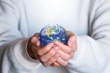 Human Holds Earth Planet Globe. Our Home. Green Planet. Environmental Protection Concept.