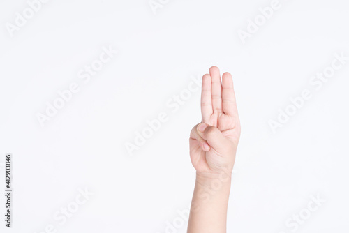 Fotografie, Obraz A kid hand with three finger salute as a symbol for protesting against dictator