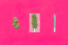 Process For Rolling A Cannabis Joint. Top View Of Steps To Roll A Marijuana Joint Isolate On Pink Background.