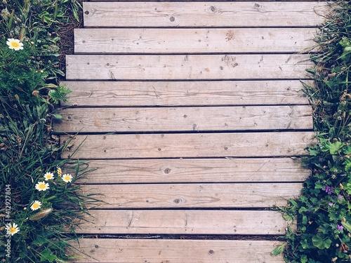 Fotografie, Obraz High Angle View Of Wooden Boardwalk On Footpath