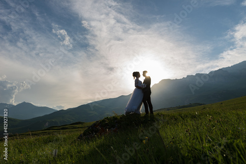 Obraz na plátně Wedding of a guy and a girl in the mountains