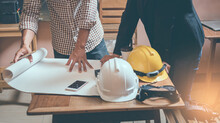 Midsection Of Architects Working At Table