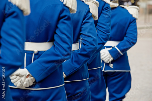 Fototapeta Rear View Of People Standing On Street In Blue Uniform