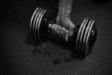 Cropped Hand Of Man Picking Dumbbell