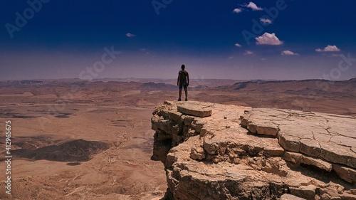 Fotografie, Tablou Man Standing On Cliff Against Sky