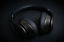 Closeup Shot Of Black Headphones On A Black Surface