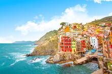 Riomaggiore On The Mountain In Cinque Terre Near Mediterranean Sea In Liguria - Italy And Sunny Cloudy Sky, Traditional Italian Architecture