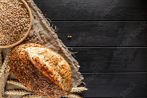 Fototapeta Fresh fragrant bread on the table. Food concept. Concept of traditional leavened bread baking methods. Healthy food. obraz
