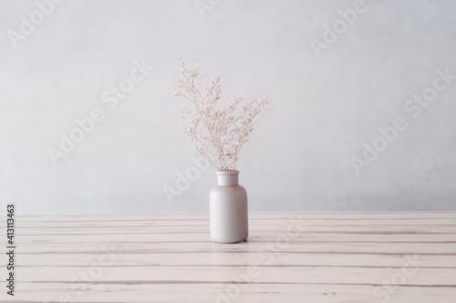 Fototapeta Wilted Flowers In Bottle On Table At Home obraz