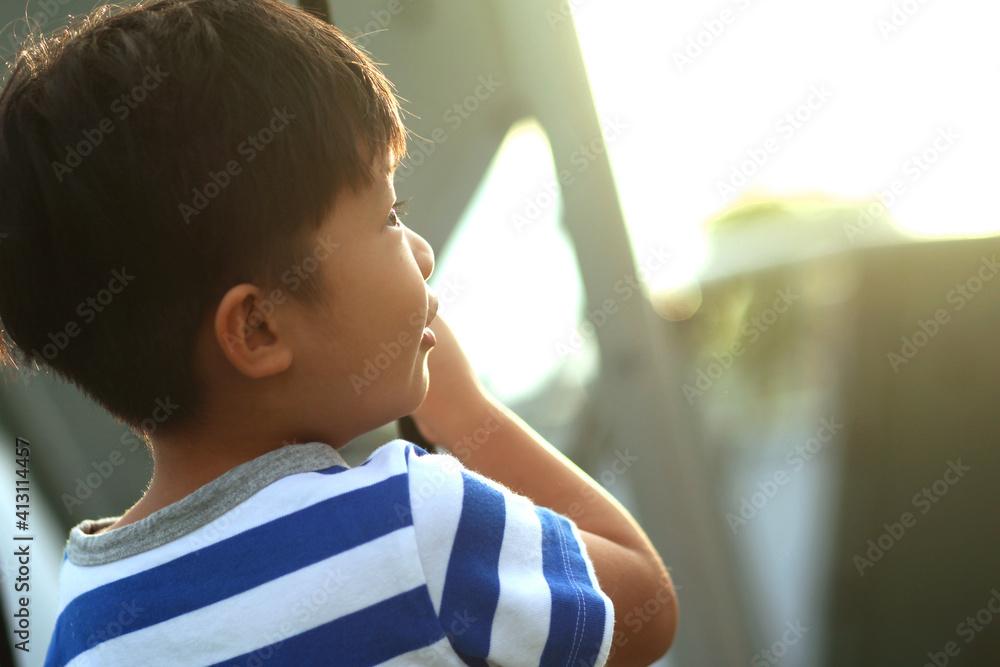 Fototapeta Close-up Of Cute Boy Looking Away Outdoors