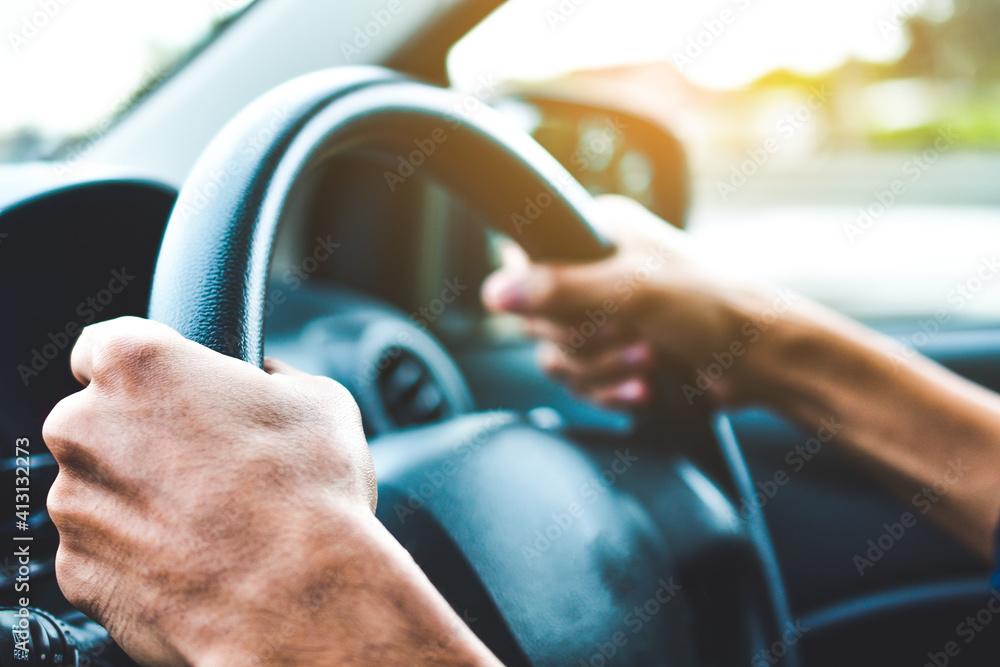 Fototapeta Cropped Hands Of Man Driving Car