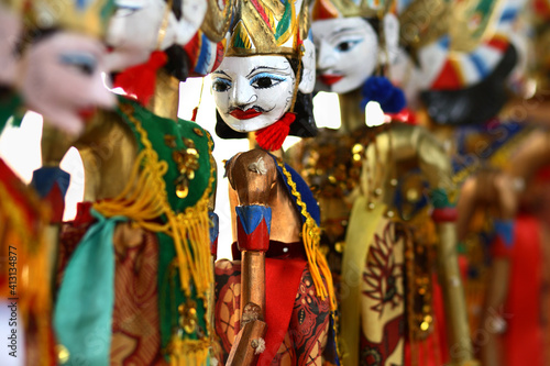 Obraz na plátně Close-up Of Multi Colored Wooden Puppets At Store
