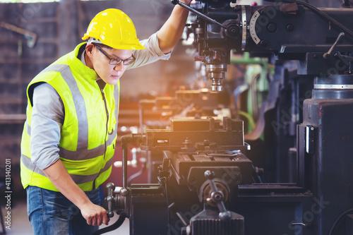 Obraz na plátně Professional engineer metalworker operating machine center in manufacturing work
