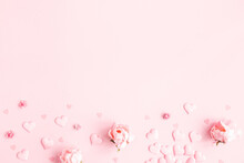 Valentine's Day Background. Frame Made Of Pink Flowers, Hearts On Pastel Pink Background. Valentines Day Concept. Flat Lay, Top View, Copy Space