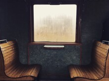 Empty Chairs And Table Against Window In Old Train