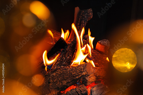 Fototapeta Wood logs burning in fireplace close up obraz