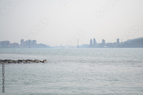 Fototapeta Scenic View Of Sea And Buildings Against Clear Sky obraz