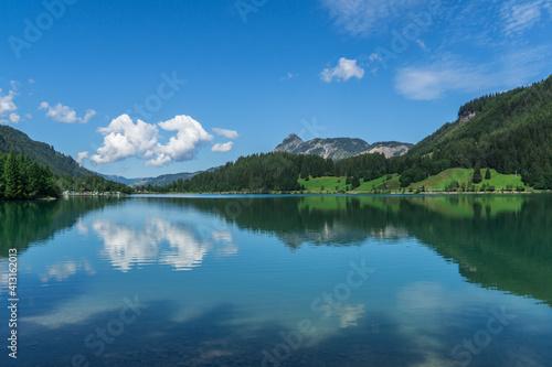 Fototapeta Scenic View Of Lake And Mountains Against Blue Sky obraz