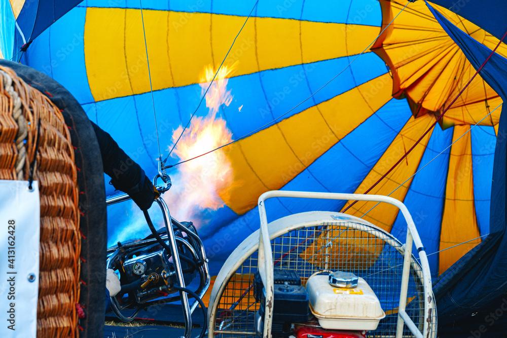 Fototapeta Close up of hot air balloon getting prepared for flight