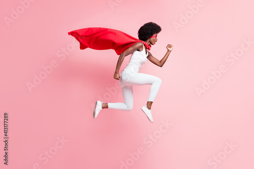 Fototapeta Full length body size view of motivated energetic girl jumping wear hero look running fast isolated on pink pastel color background obraz