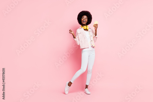 Obraz Full length body size view of lovely cheerful girl listening single pop hit bass dancing enjoying isolated over pink color background - fototapety do salonu