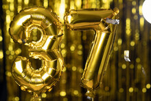 The Golden Number 37 Thirty Seven Is Made From An Inflatable Balloon On A Yellow Background. One Of The Complete Set Of Numbers. Birthday, Anniversary, Date Concept