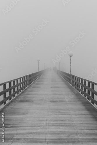 Fotografia, Obraz Empty Footbridge In Fog Against Sky