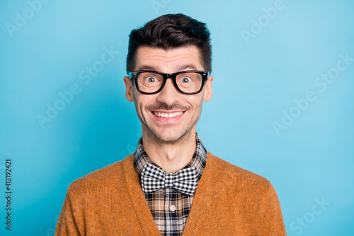 Fototapeta Portrait of satisfied young person beaming smile look camera isolated on pastel