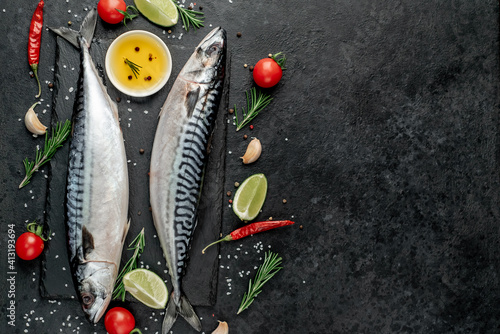 Fototapeta  Fresh raw mackerel fish on stone background with copy space for your text   obraz