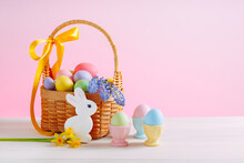Basket With Flowers And Decorated Eggs For The Easter Holiday. Colorful Eggs In Egg Stands. Homemade Rabbit Cookies
