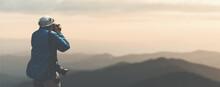 Nature Photographer Shoots A Mountain Landscape