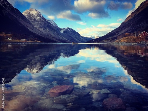 Fototapeta Scenic View Of Lake And Mountains Against Sky