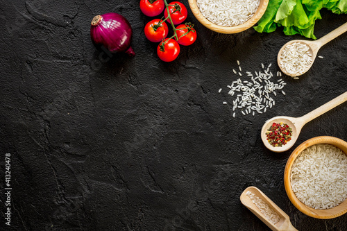 ingredients for paella on dark background top view