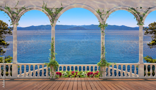 Terrace with white colonnade and balustrade, overlooking the sea and mountains Fototapeta