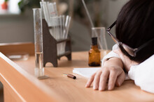 Tired Woman In White Coat Fell Asleep From Fatigue At Work In Research Laboratory
