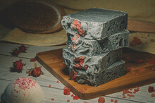 Still Life Of A Handmade Soap Stack On A Wooden Board. Focus On The Soap Stack