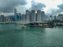 View Of The Skyscrapers, Tsing Yi North Bridge And Nina Tower In Tsuen Wan District In Hong Kong. City Skyline. Asia