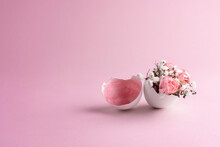 Pink And White Flowers In Eggshell On A Pink Background