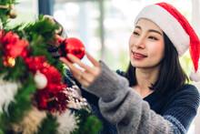 Beautiful Woman Decorating Christmas Tree At Home