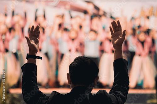 Fényképezés Rear View Of Man Conducting Choir