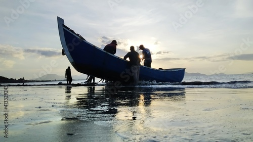 Obraz na plátne Fishermen Clean Up Nets On The Beach After Fishing In Banda Aceh
