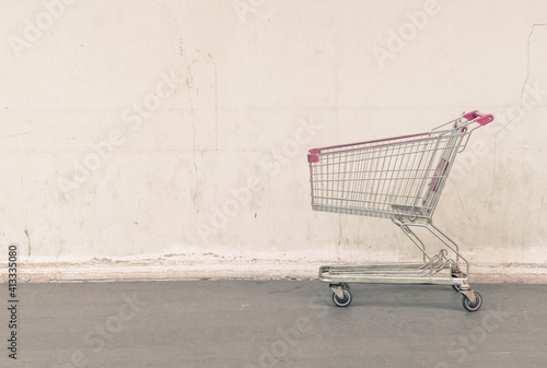 Canvas View Of Shopping Cart Against Wall