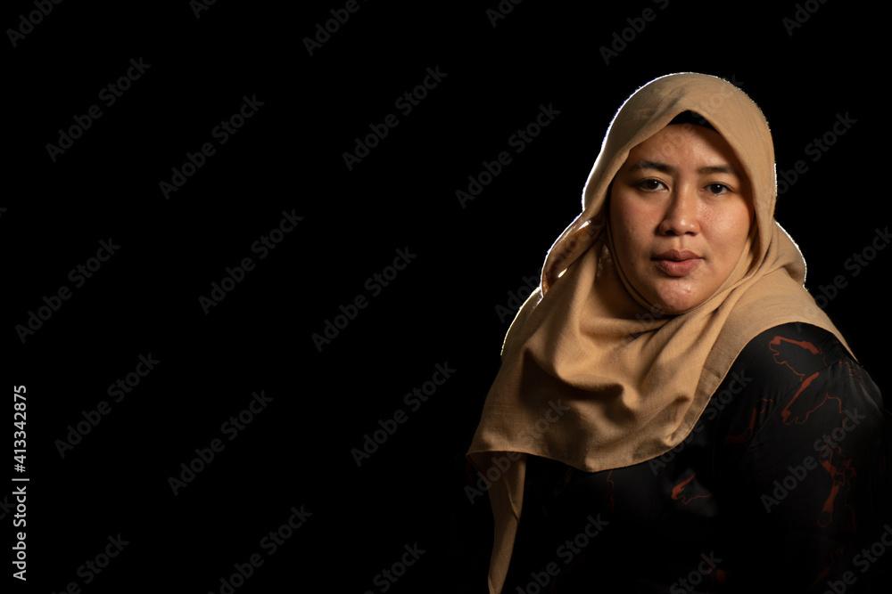 Fototapeta Portrait Of Woman In Hijab Against Black Background