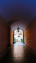 An Arched Passageway Building In The Town Of Lucca, Italy.