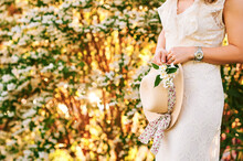 Spring Garden, Woman Holding Straw Hat And Jasmine Branch