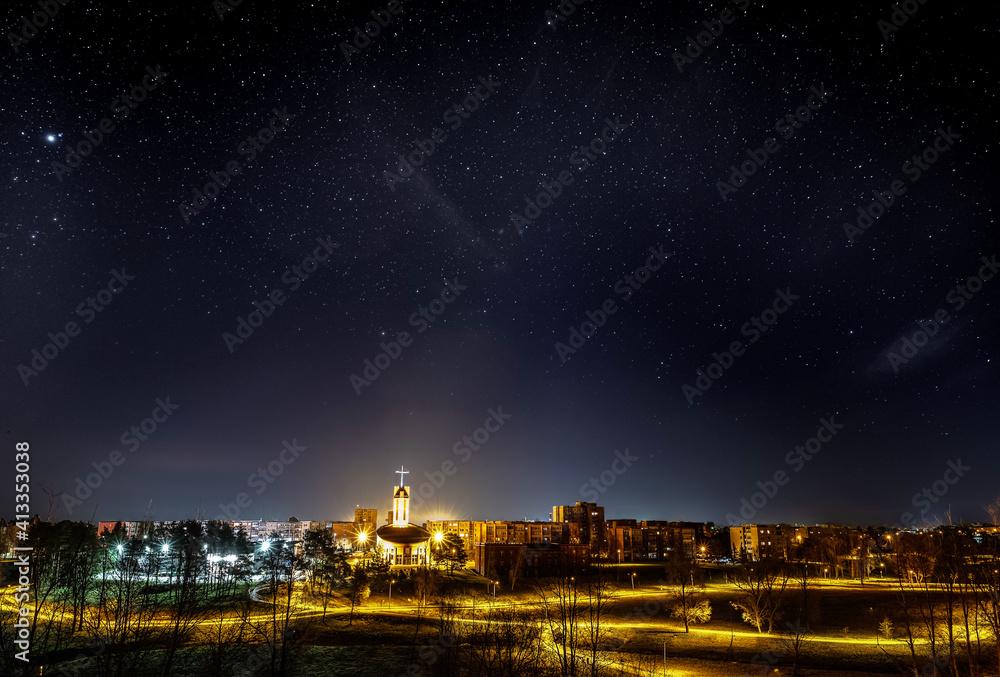 Fototapeta Illuminated Buildings In City At Night