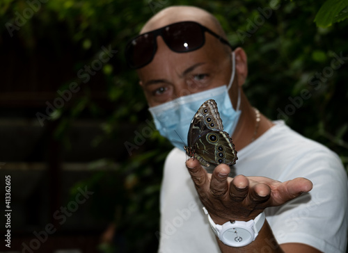 Fotografia, Obraz A Butterfly In His Hands... In Spite  Of Everirything