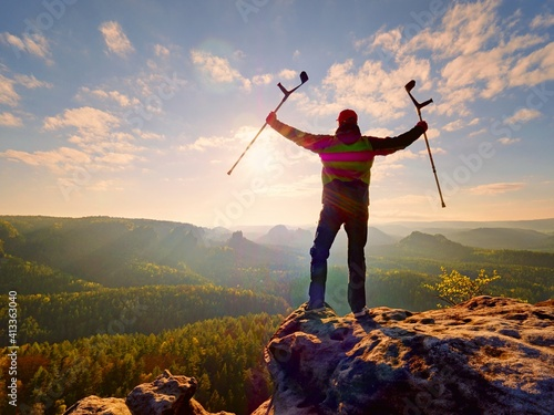 Canvas Hiker With Medicine Crutch Above Head Achieved Personal Target