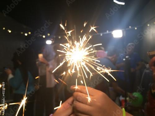 Close-up Of Hands Holding Sparkler