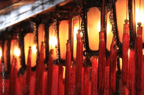 Fototapeta Close-up Of Illuminated Lantern Hanging In Temple
